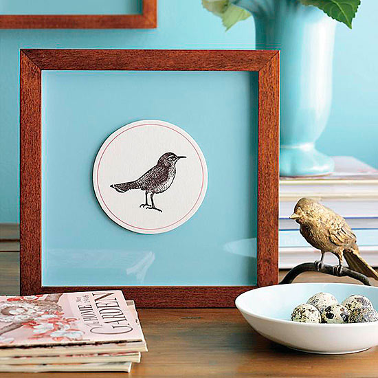 framed bird print on table
