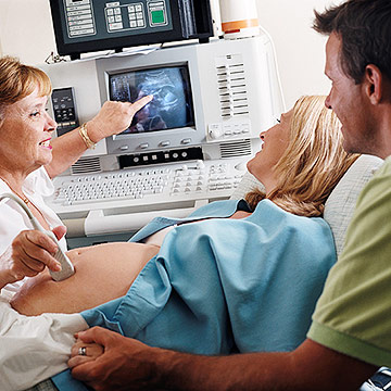 pregnant couple getting ultrasound
