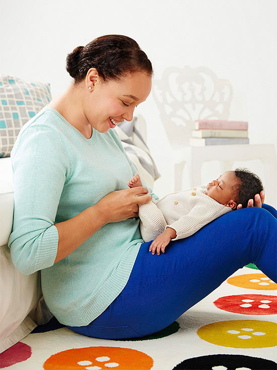 woman sitting holding baby