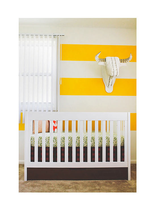 White crib with green crib sheet