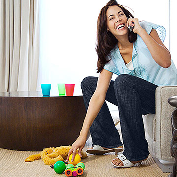 woman picking up toys