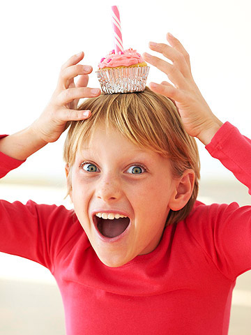happy child holding cupcake