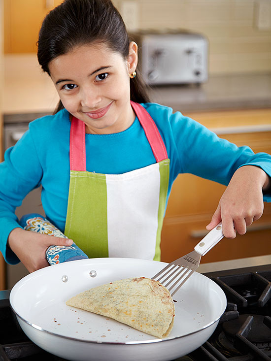 Girl cooking a quesadilla