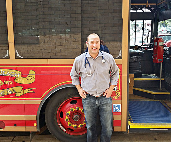 Dr. Matthew Cohen in front of a trolley