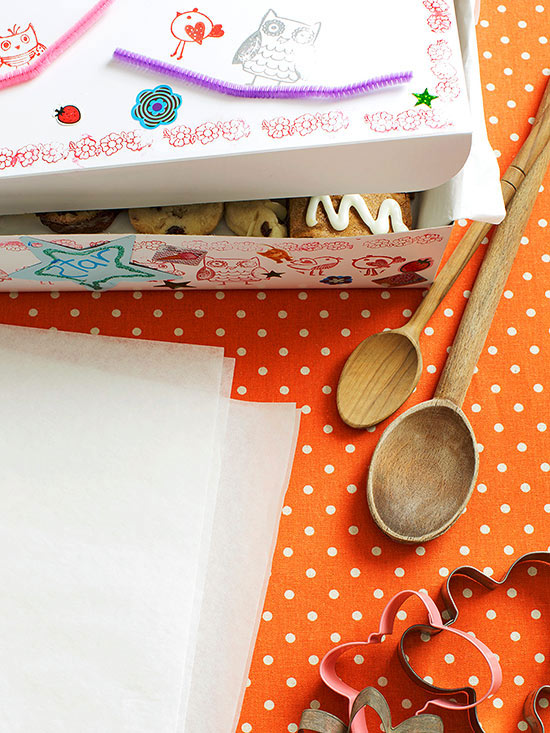 Table layout with cookie box at top, wooden spoons, and cookie cutters-1412718168195.xml
