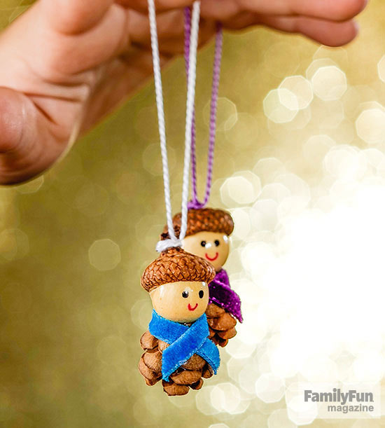 Acorn people ornaments with purple and blue ribbon scarves