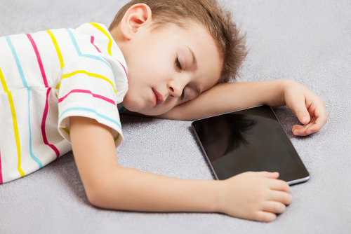 Sleeping boy with tablet