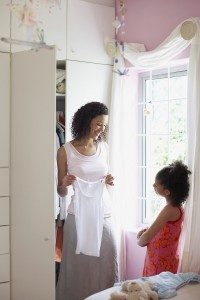 mother and daughter looking at clothes