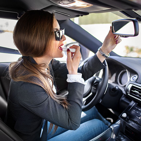 Putting on makeup in car
