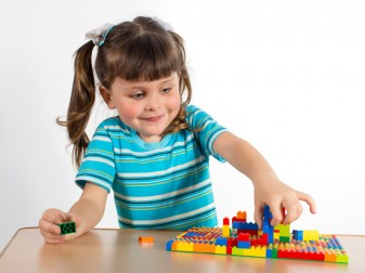 girl playing with legos