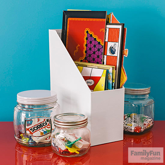 Jars and white file folder on top or red bookcase
