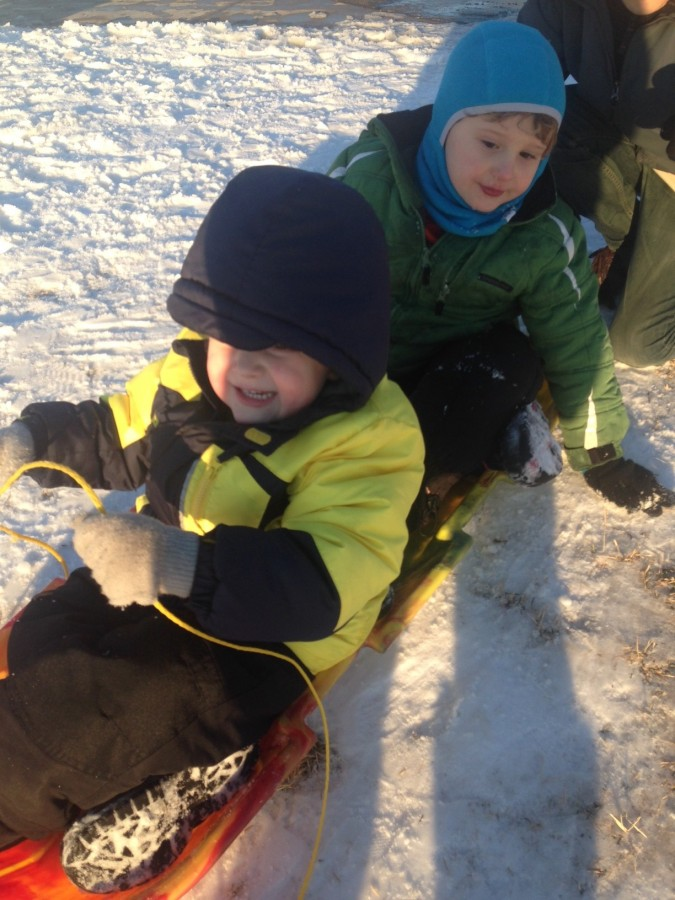 Liam and his brother sledding