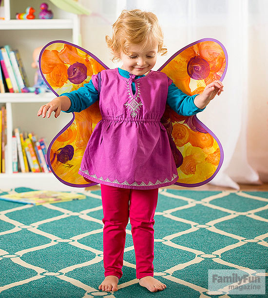 child wearing wings