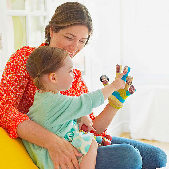 Mom and girl with Familiar Faces Finger Puppet