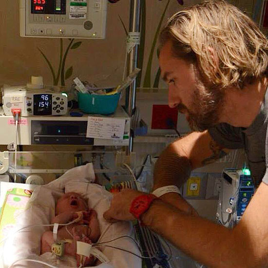father looking at baby preemie