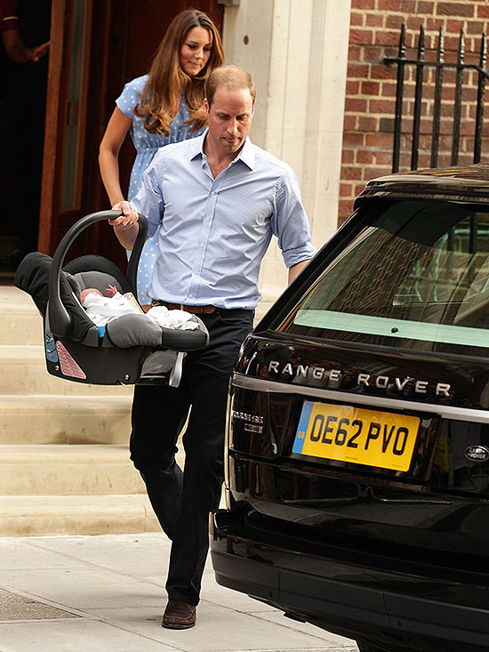 William carrying son Prince George to car
