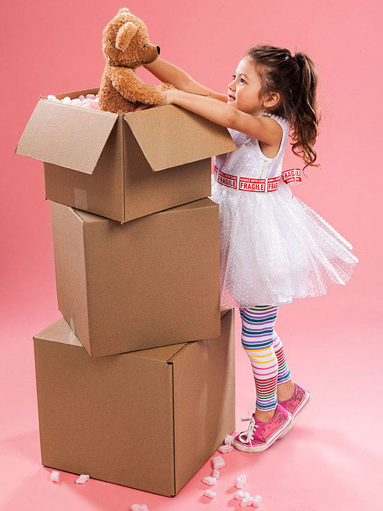 child packing moving box