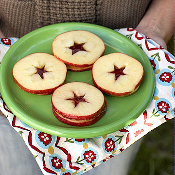 Sliced apple and PB&J sandwiches