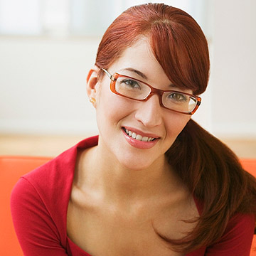 woman wearing glasses with side swept bangs