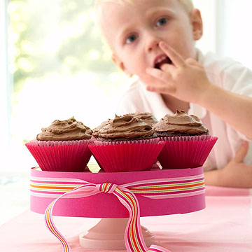 child eating cupcake
