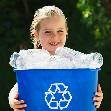 child holding recyclables-1302908995225.xml
