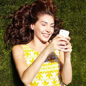 woman looking at her cell phone