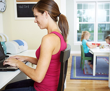 mother working on computer