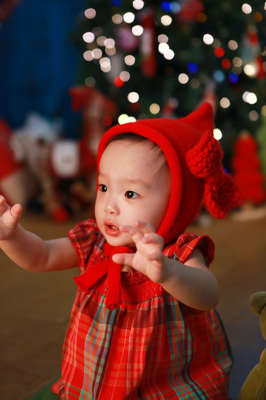 asian baby girl red dress christmas tree holidays