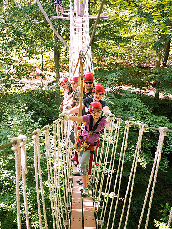 Family on rope bridge