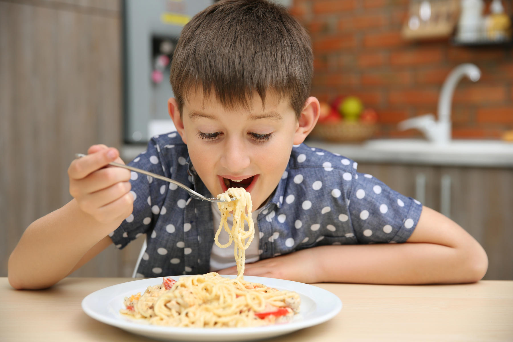 Boy Eating Spaghetti