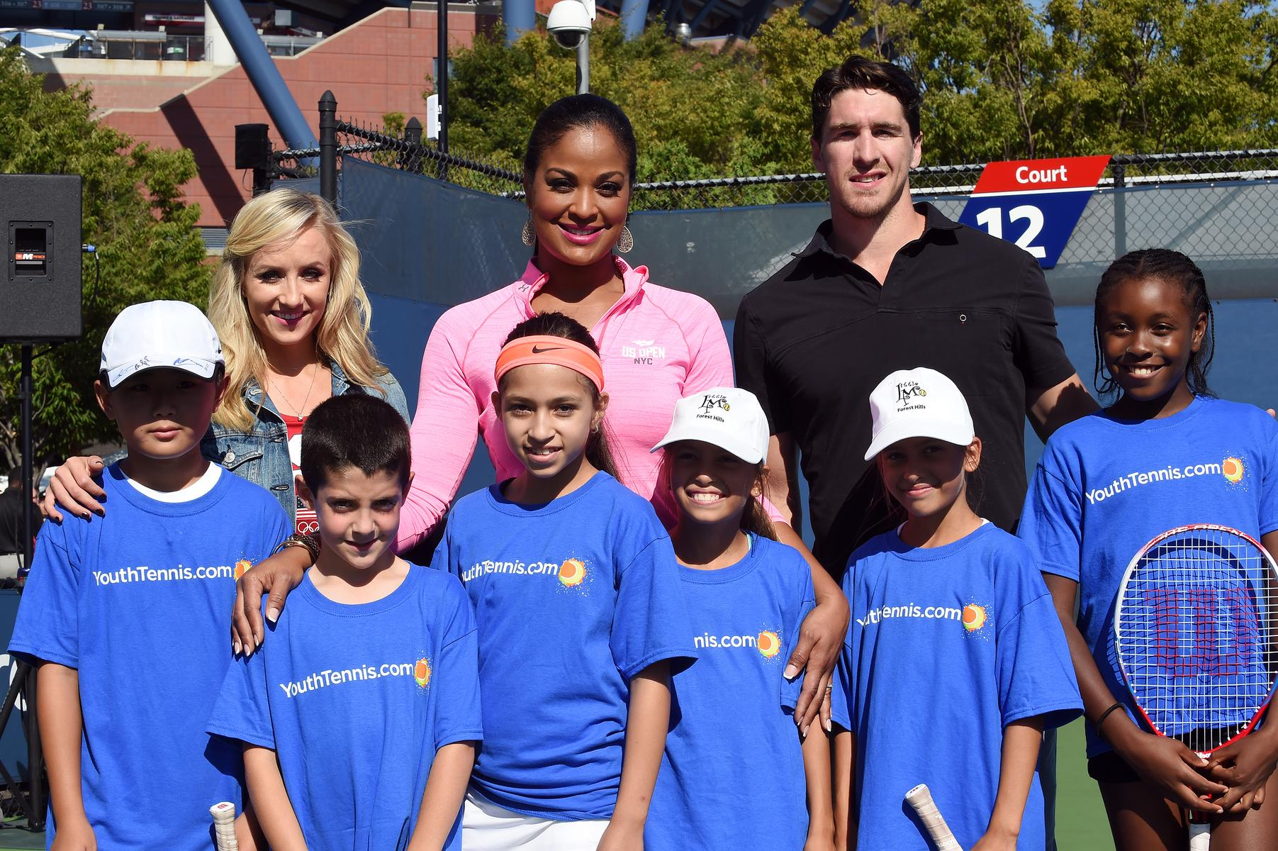 Six kids with tennis players