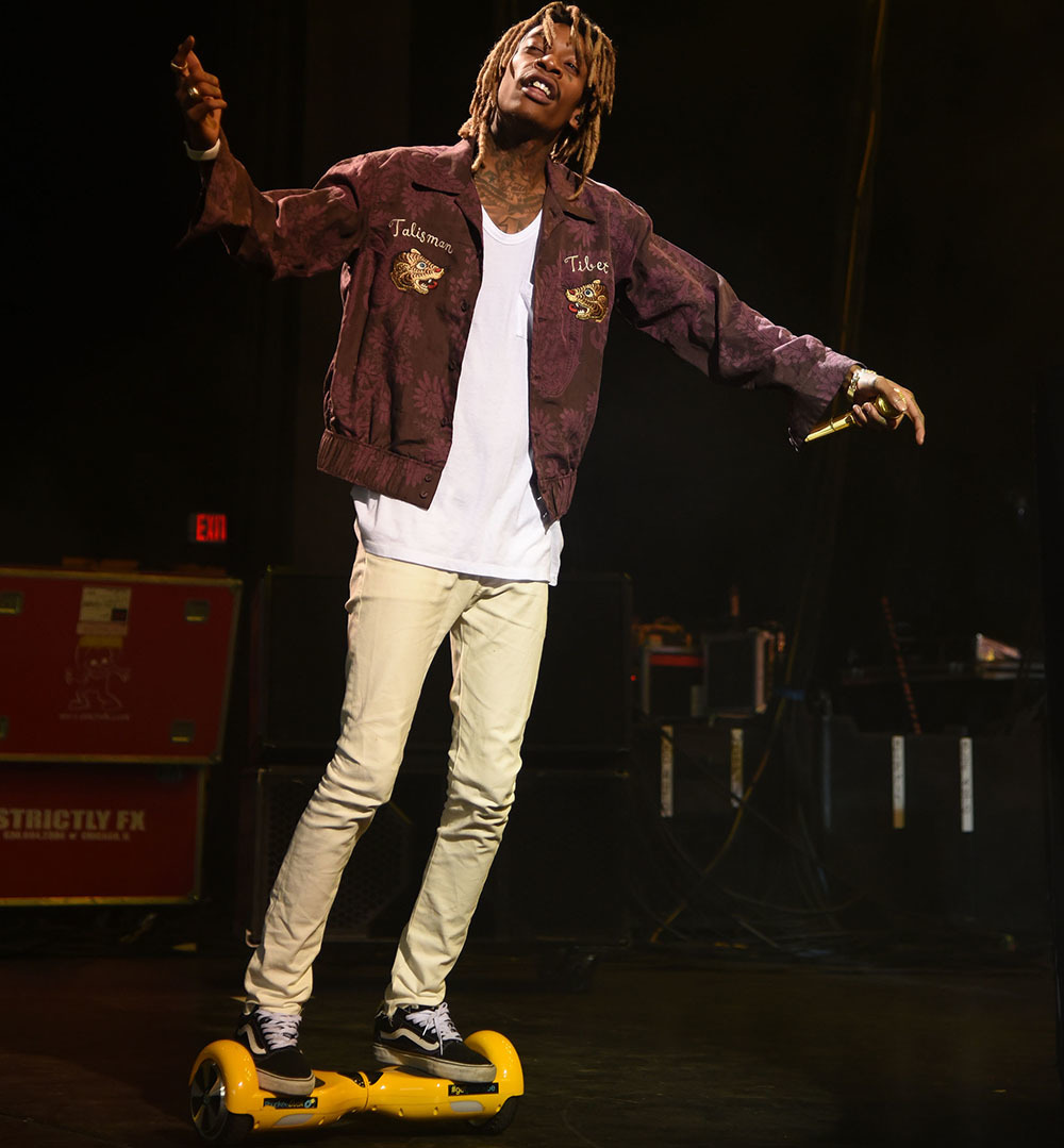 Wiz Kalifa riding hoverboard