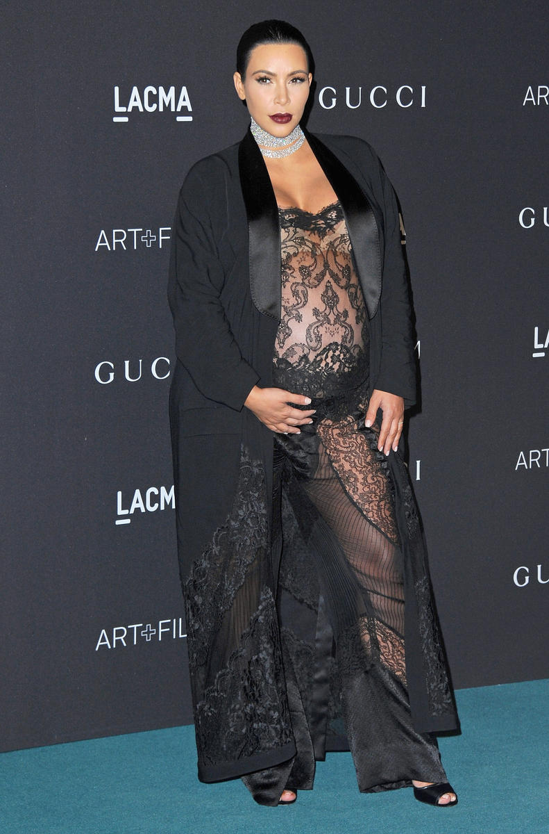 Pregnant Kim Kardashian in black lace see-through jumpsuit