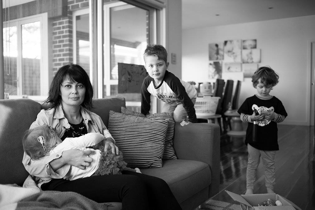 Mom Sofi nurses while her two older sons entertain themselves