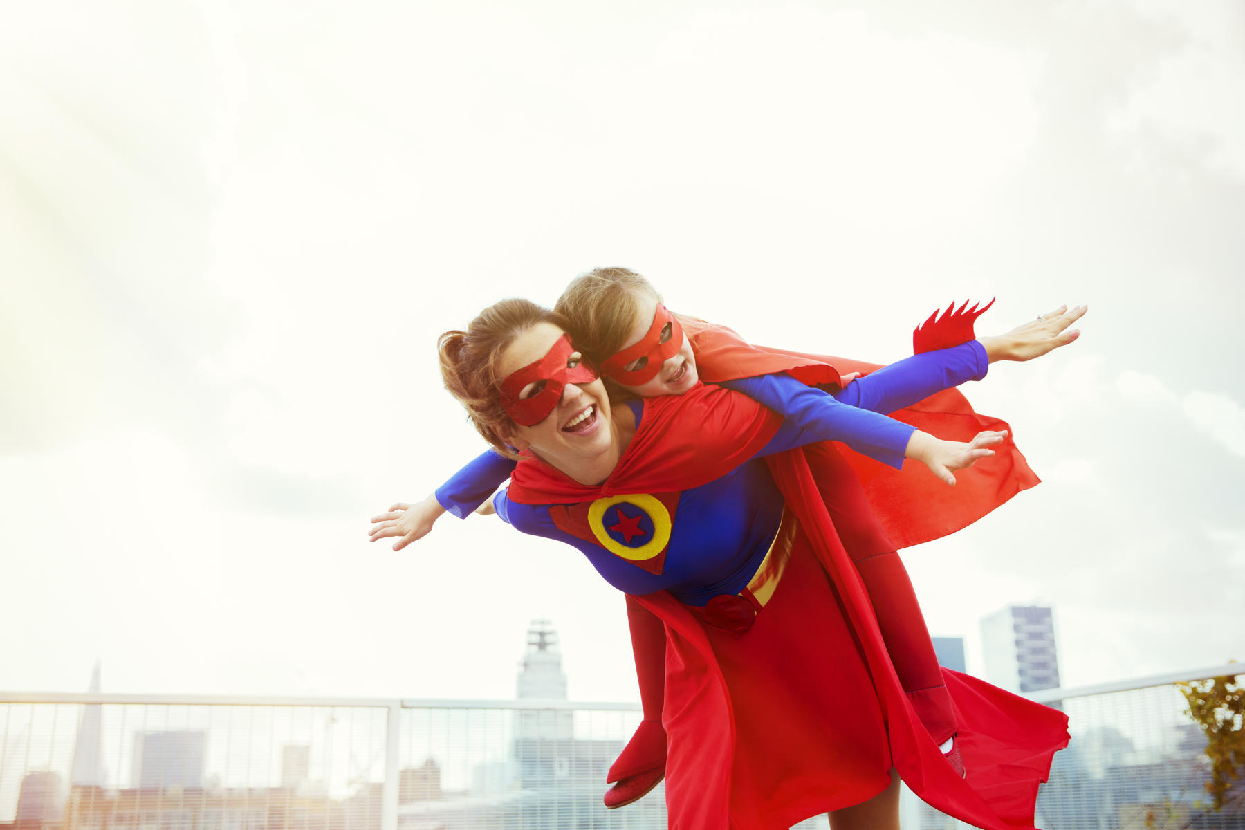 Mom and Child in Superhero Costumes