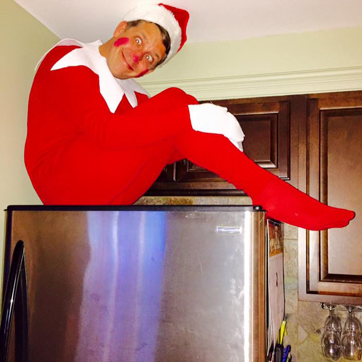 dad elf on the shelf on fridge