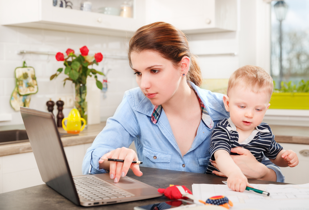 mom-on-computer-with-baby