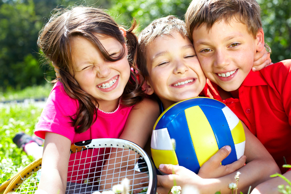 kids with sports equipment