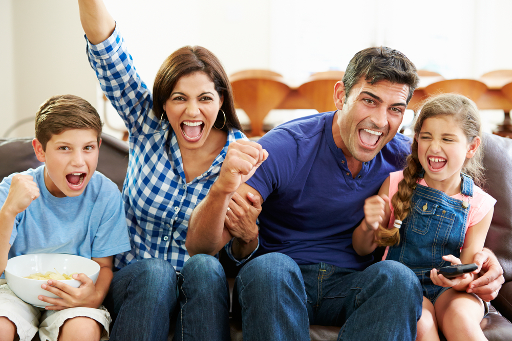 Family watching Olympics on TV