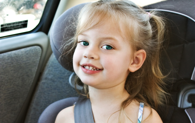 little girl in car booster seat
