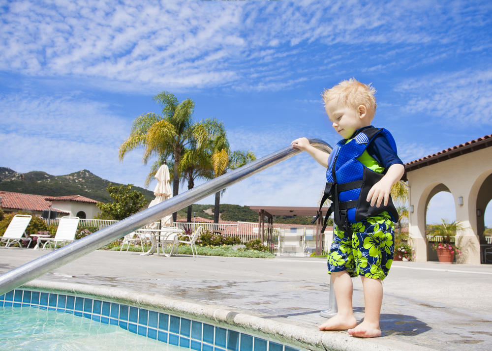 Pool Pledge Toddler in Life Jacket Steps In Pool
