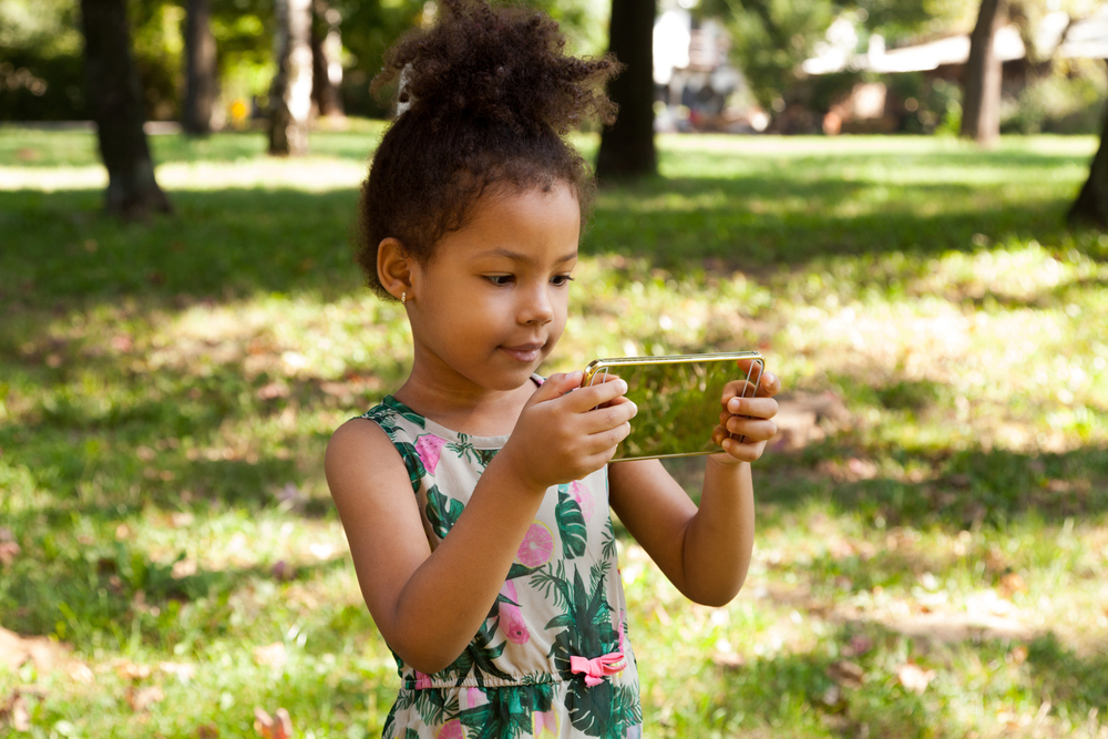 young girl using smartphone