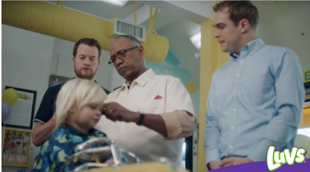 Luvs Ad Features Gay Dads Hilariously Obsessing Over Child's First Haircut