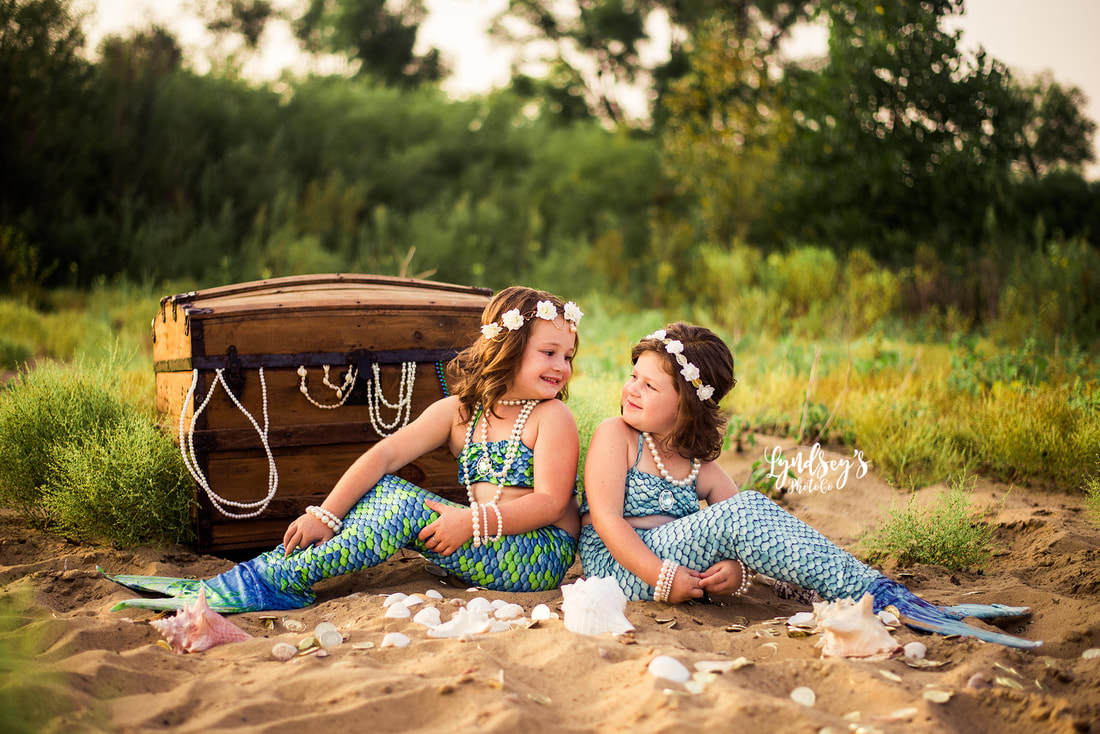 sister mermaids soak up photo shoot fun