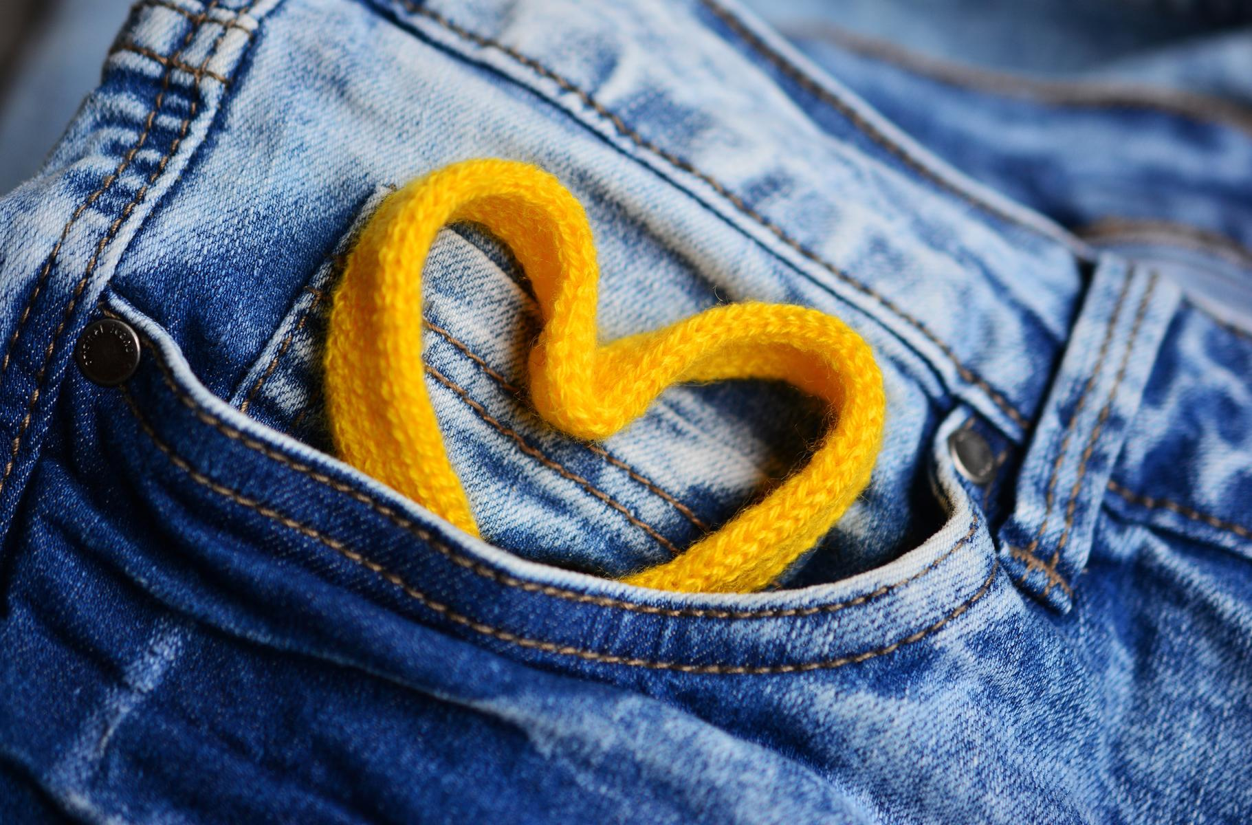 Closeup Jeans Denim Pants Yellow String Heart In Pocket