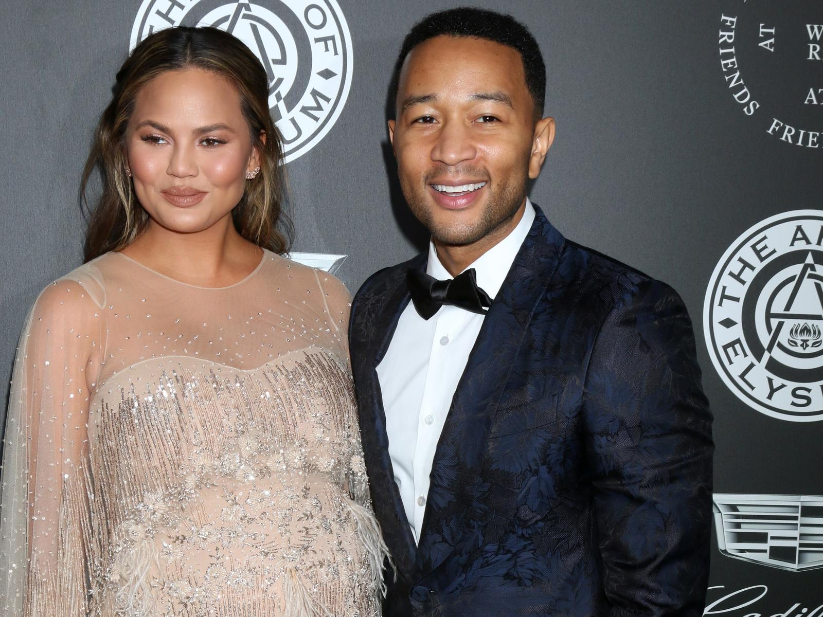 Chrissy Teigen and John Legend Gold Dress Black Tuxedo