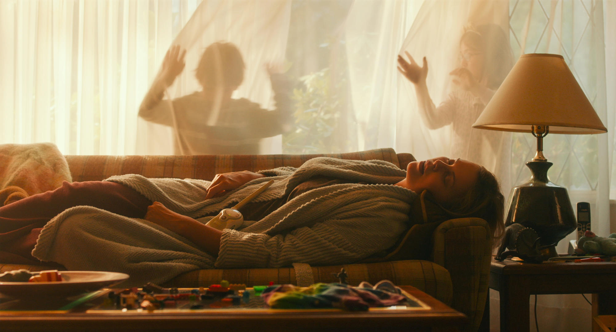 Charlize Theron in Movie Tully Sleeping on Couch