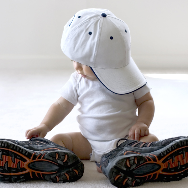 baby-wearing-baseball-cap-and-dads-sneakers_600x600_shutterstock_1050951