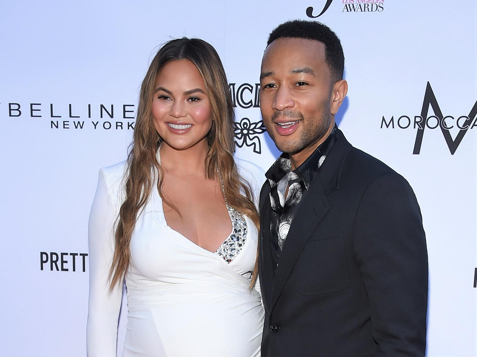 White Dress Chrissy Teigen and Husband John Legend
