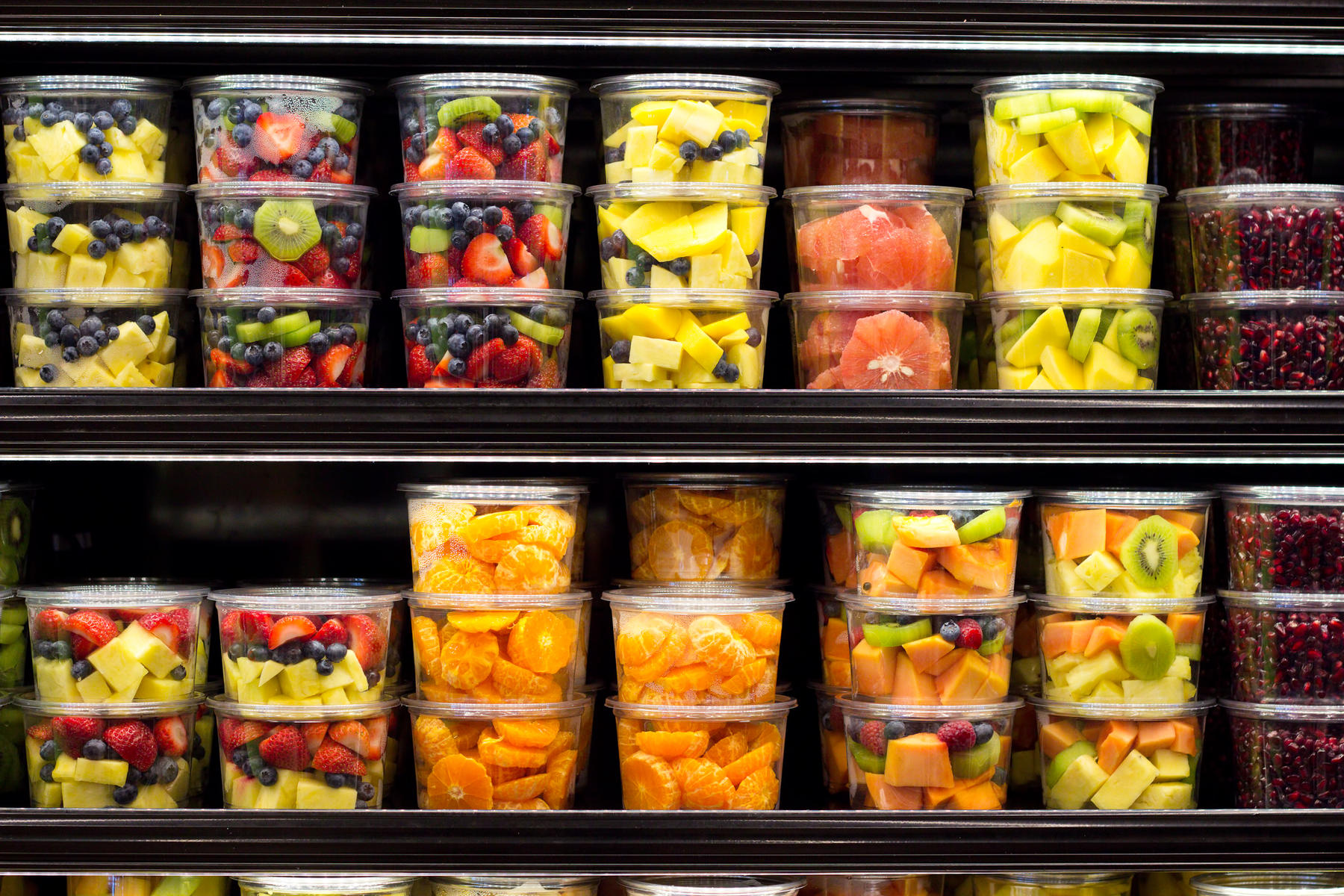 Assortment of Cut Fruit In Plastic Containers